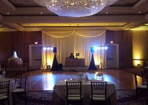 DJ setup with drape uplighting amber